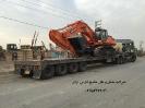 حمل بیل مکانیکی دوسان520 DOOSAN ازمبدا گمرک بندرعباس به مقصد شهرک کامیونداران اسلامشهر توسط کمرشکن 11محور شرکت خلیج فارس ترابر