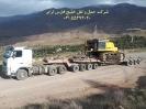 حمل بیل مکانیکی 800 کوماتسو (komatsu) از مبدا اصفهان به مقصد کارخانه سیمان رشت اوسط کمرشکن 11 محور شرکت حمل و نقل خلیج فارس ترابر