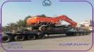 حمل بیل مکانیکی ۵۲۰ دوسان از بندرعباس به مقصد زنجان توسط کمرشکن ۱۱ محور کف صاف